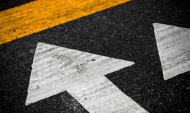Urban road marking. White arrows and yellow line Royalty Free Stock Image