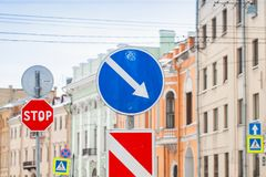Urban road signs over houses walls. Urban road signs over living houses walls stock photos