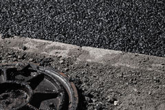 Urban road under construction, asphalting in progress Stock Photography