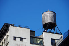 Urban roof top water tower Stock Images