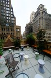 Urban rooftop terrace. Rooftop terrace or patio in downtown Manhattan, New York City Stock Images