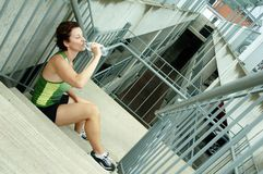 Urban Runner. Mature woman runner in the city royalty free stock photography