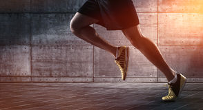 Urban runner. Close up of urban runner's legs run on the street with copy space Royalty Free Stock Image