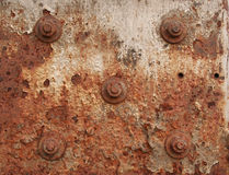 Urban rust texture. In brown with five screws Stock Image