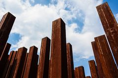 Urban Rusted Metal Poles With Blue Background Stock Images