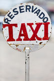 Urban rusty metal taxi sign in Uruguay Stock Photography