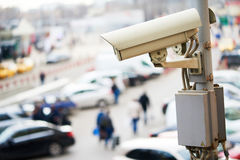 Urban safety and security. CCTV camera or surveillance operating in city Royalty Free Stock Image