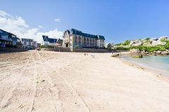Urban sand beach in breton town Perros-Guirec Royalty Free Stock Image
