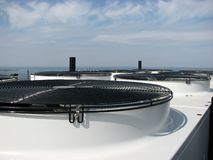 Urban scene 1. Water condenser on the roof Stock Photography