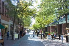 Urban scene. People shopping and eating in restaurants into the mall, Salem, Massachusetts royalty free stock photos