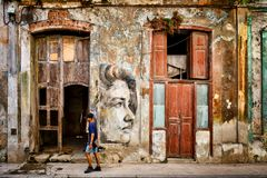 Urban scene with beautiful but decaying building in Old Havana. HAVANA,CUBA - NOVEMBER 6, 2017 : Urban scene with beautiful but decaying building in Old Havana Stock Images