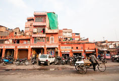 Urban scene with bikes near the walls of historical Pink City. Royalty Free Stock Photo