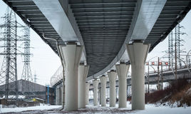 Urban scene with bottom view of steel bridge Stock Image