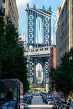 Urban scene in Brooklyn with the Manhattan Bridge at he end of n. Arrow street royalty free stock photo
