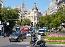 Urban scene at Calle de Alcala in central Madrid. Street scene at Calle de Alcala in central Madrid with a view of several landmarks stock image