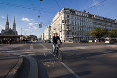 Urban Scene at a crossing in the city of Vienna with people cars and bicycle Stock Image