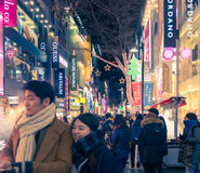 Urban scene with crowd people at  shopping street at night  in. Seoul, Republic of Korea - January 1, 2015 :  Urban scene with crowd people at  shopping street Stock Images