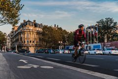 Cyclist in the streets of Paris royalty free stock photos