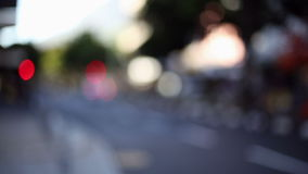 Urban scene in the evening. Out of focus shot stock footage
