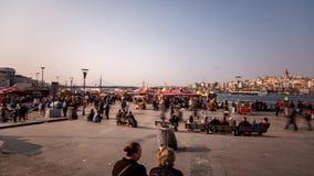 Urban Scene Istanbul. Urban scene of people walking and shopping near the Galata bridge and the ocean stock video
