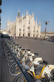 Urban scene of Milan and bikes for urban transport. Concept of ecology in city Stock Photo
