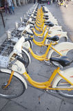 Urban scene of Milan and bikes for urban transport Royalty Free Stock Images
