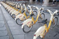 Urban scene of Milan and bikes for urban transport. Concept of ecology in city Royalty Free Stock Photos