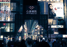 Urban scene at night around Kansai in Osaka , Japan. Osaka, Japan - February 2 , 2015 : Urban scene at night with many people around Kansai area in Osaka , Japan Stock Images