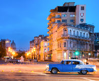 Urban scene at night in Old Havana. With a view of the street lamps and the old buildings near El Prado Stock Photo