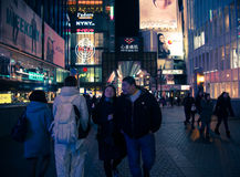 Urban scene at night in Osaka , Japan. Osaka, Japan - February 2 , 2015 : Urban scene at night with many people around in Osaka , Japan Stock Photos