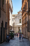 Urban scene with an old church at a narrow street in Rome Stock Photography
