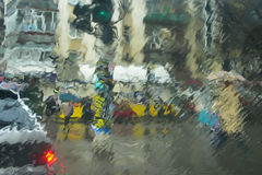 Urban scene through window. A view of an urban scene through a wet window Stock Photography