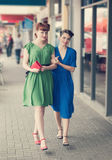 Urban scene with young women Stock Photography