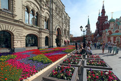 Urban scenic with flower bed on Nikolskaya Street. Historic cent Royalty Free Stock Image