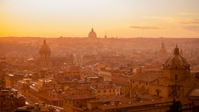 Urban scenic of Rome with dome and churches on the sunset. Royalty Free Stock Photos
