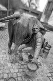 Urban sculpture of a farmer stock image