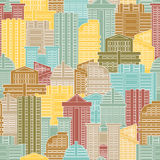 Urban seamless pattern. Colorful buildings in city, metropolis. Stock Images