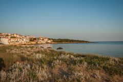 Urban and seascape at sunset in Arcudi on Peloponnese, Greece. Urban and seascape at sunset in Arcudi on Peloponnese in Greece stock photos