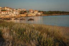 Urban and seascape at sunset in Arcudi on Peloponnese, Greece. Urban and seascape at sunset in Arcudi on Peloponnese in Greece royalty free stock photo
