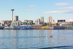 Urban Seattle skyline along the city piers in Washington, USA. Stock Photos