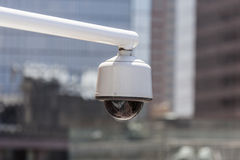 Urban Security Camera. Urban overhead security camera with cityscape background Stock Photos