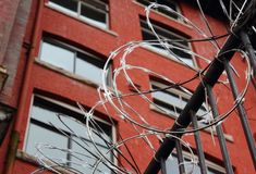 Urban Security, Razor Wire. Razor wire provides security for a downtown building. Crime prevention Royalty Free Stock Images