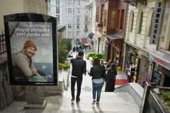 Urban sequence in Istanbul, turkish telekom comercial. Poster of joyfull man looking at the camera in urban setting of Istanbul, couple walking seen from behind Stock Photography