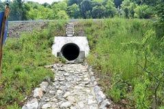Urban sewerage hole, urban wastewater pipes.  Royalty Free Stock Photo