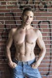 Urban shirtless man in blue jeans Royalty Free Stock Images