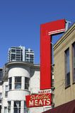 Urban Shop Sign. A blank sign along the edge of a building in San Franciscos' North Beach neighborhood stock photo