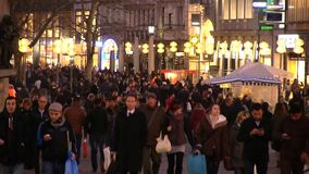 Urban Shopping Scene Munich. Urban scene in Munich showing walking and shopping people in the famous shopping street in the evening stock video