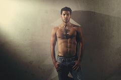 Urban shot of handsome man shirtless Stock Images