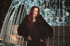 Urban shot of red haired woman Royalty Free Stock Photos
