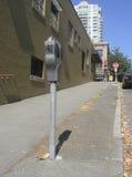 Urban Sidewalk. Parking meter on an uphill sidewalk in Seattle's Belltown district Royalty Free Stock Photo